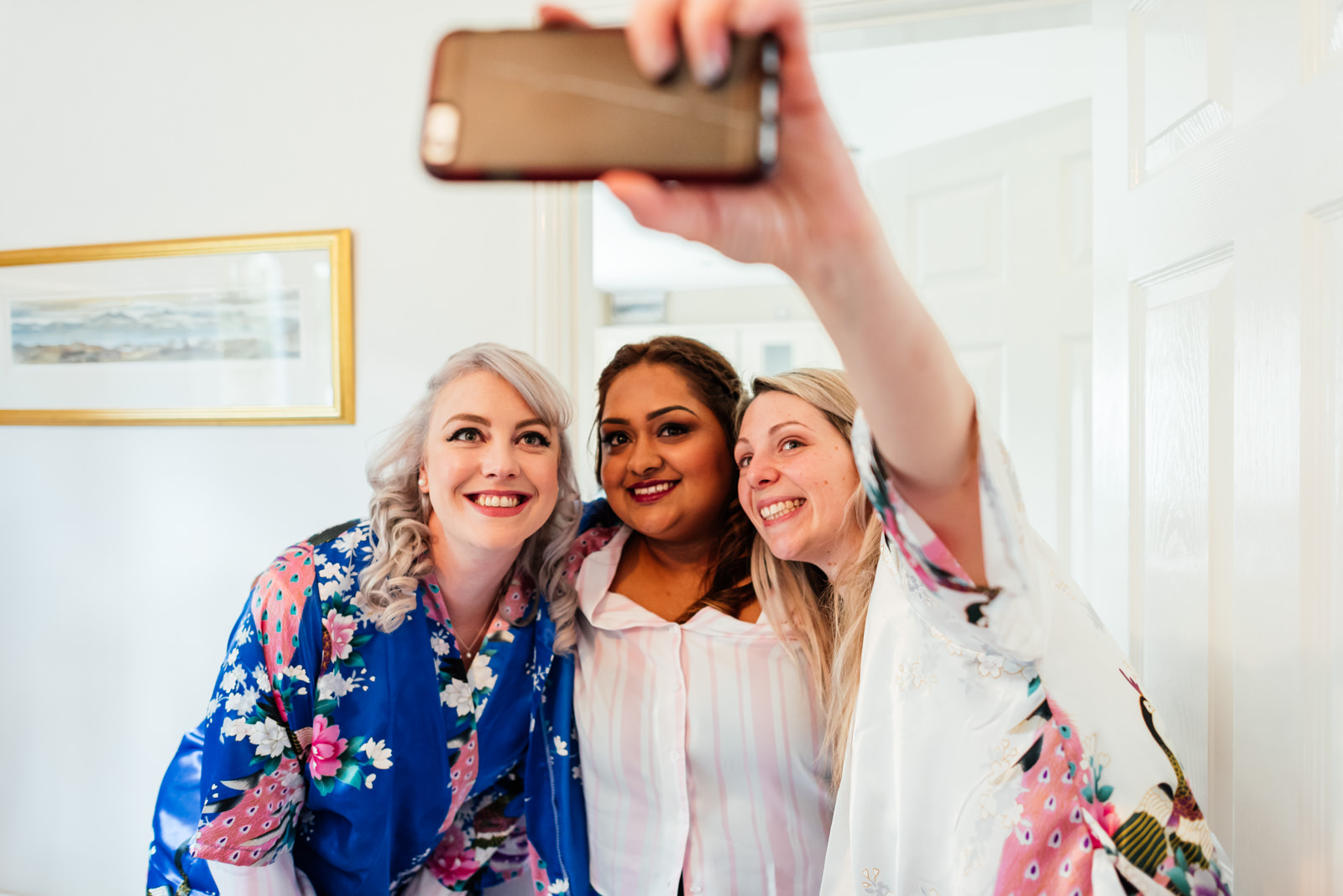 bridesmaids and bride doing a selfie