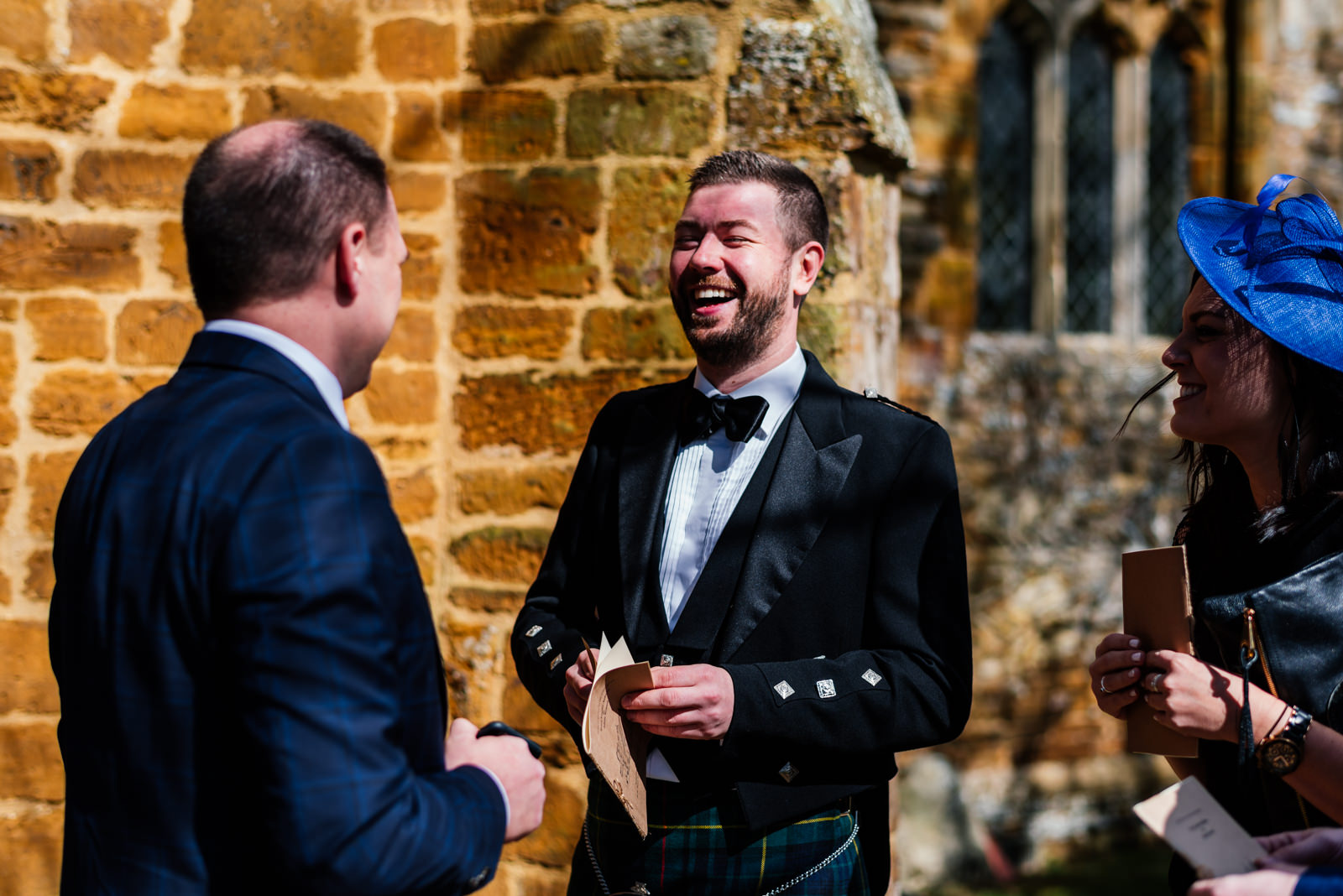 guests laughing with groom