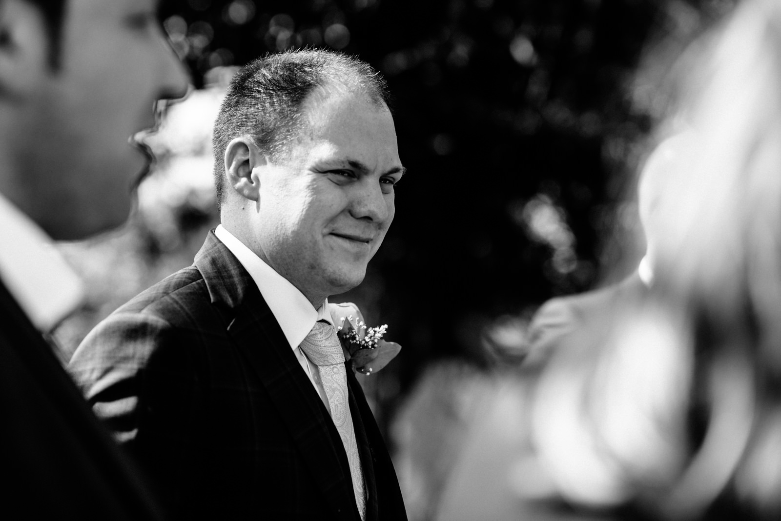black and white image of groom
