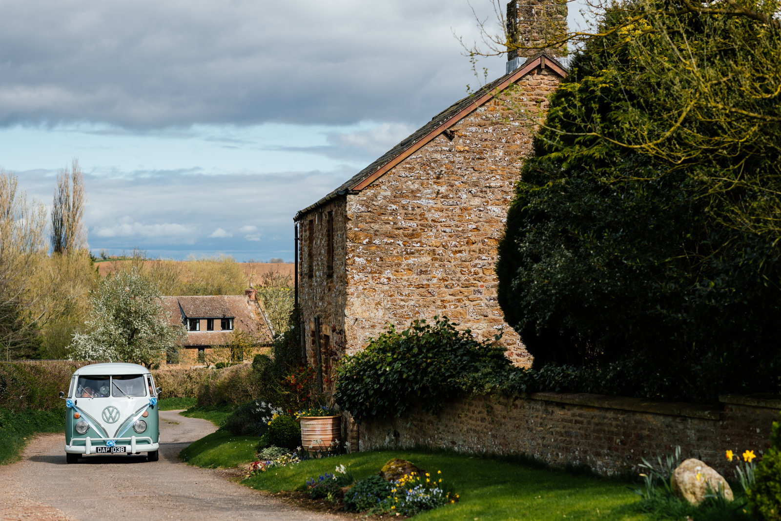 camper van arriving at church with bride and bridesmaids