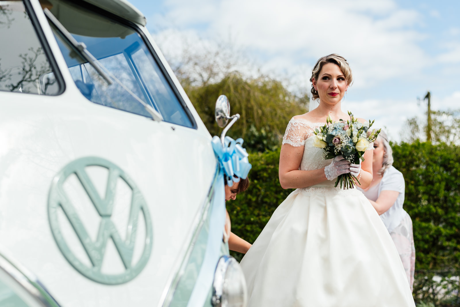 bride standing next to camper van just before walking to church