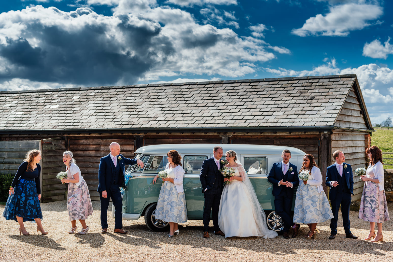 wedding party posing in front of campervan