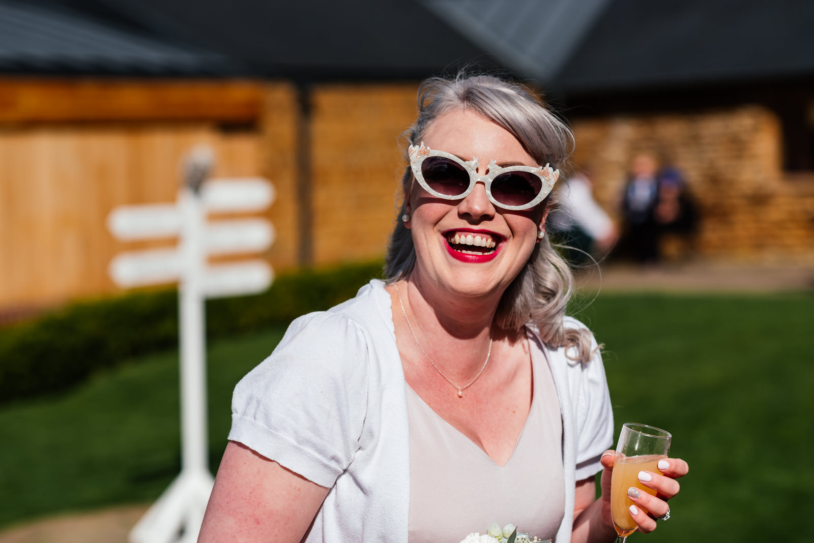 bridesmaid with sunglasses on smiling