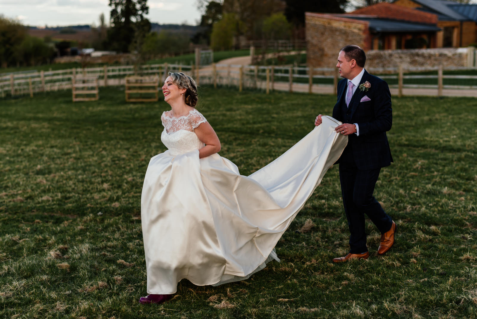 bride and groom walking in dodford field