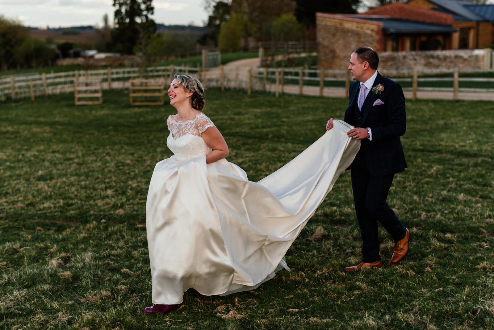 bride and groom walking in dodford field