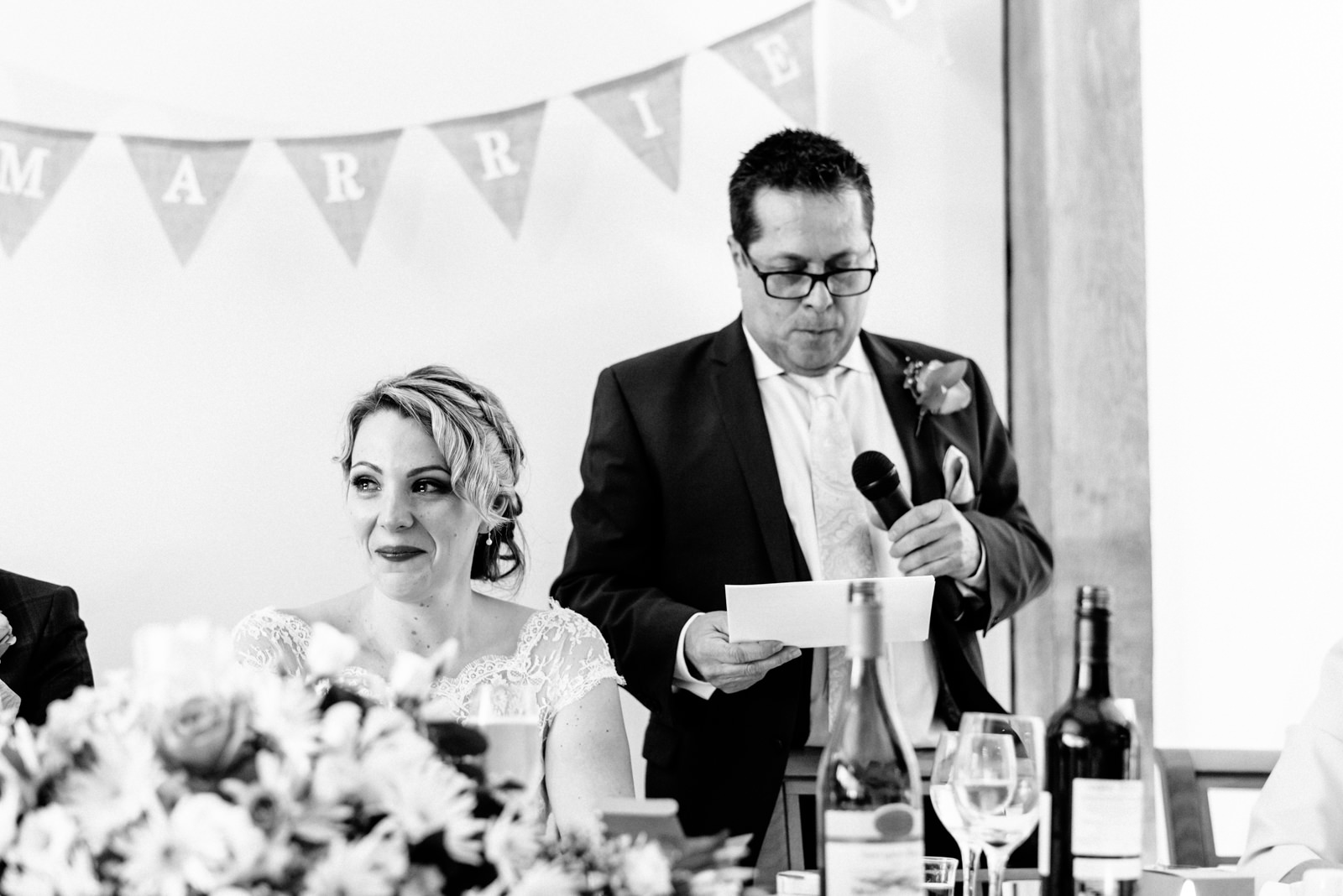 bride listening to fathers speech