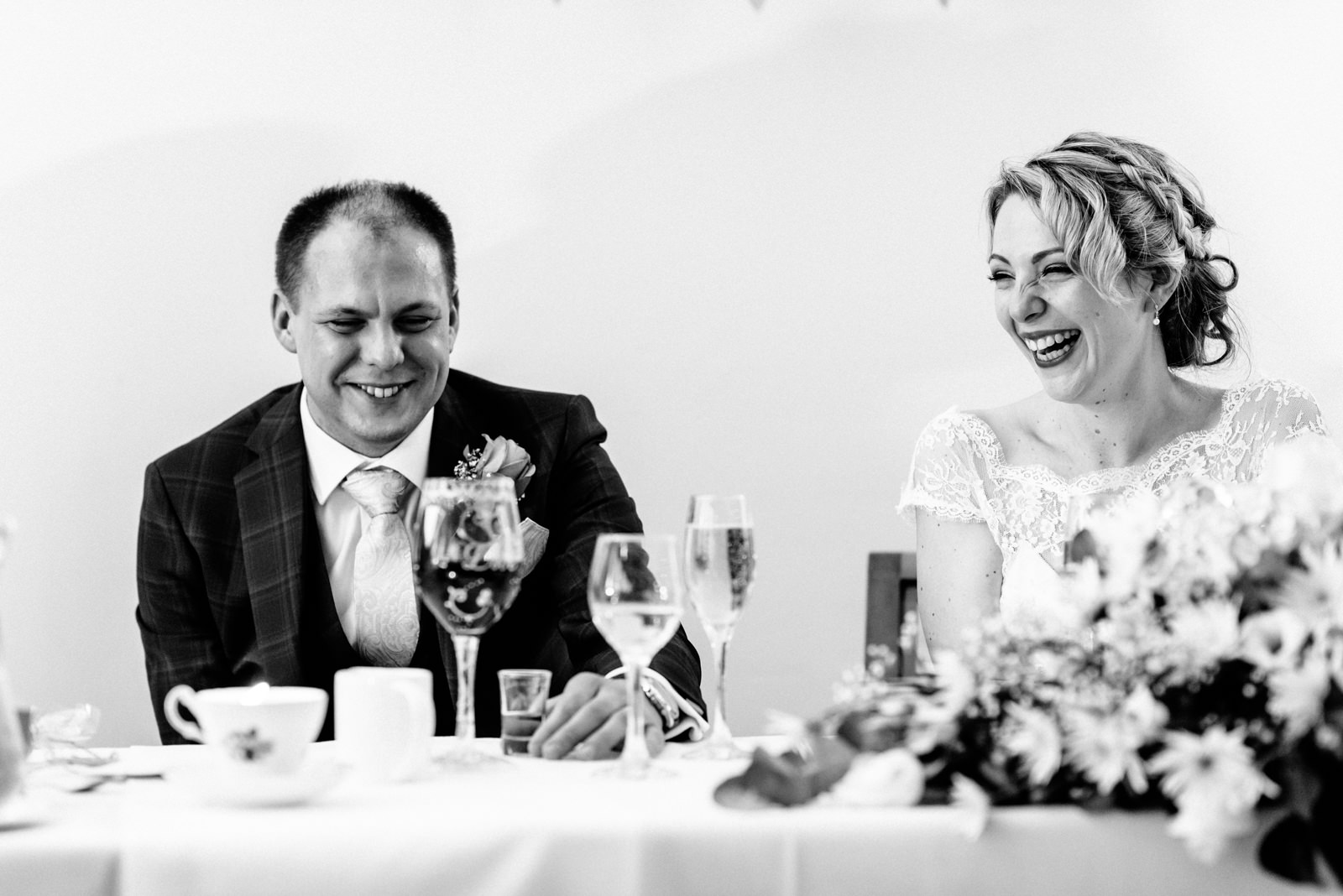 bride and groom listening to speeches