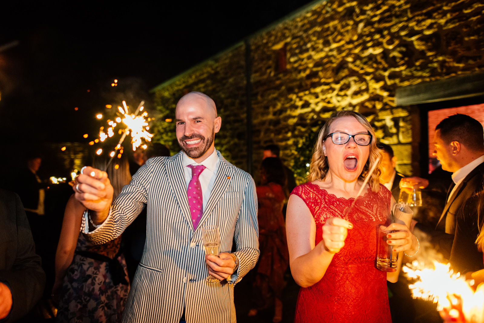 guests having fun with sparklers in the evening