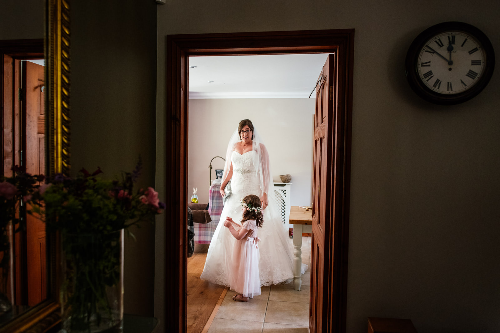 bride in the dress with flower girl