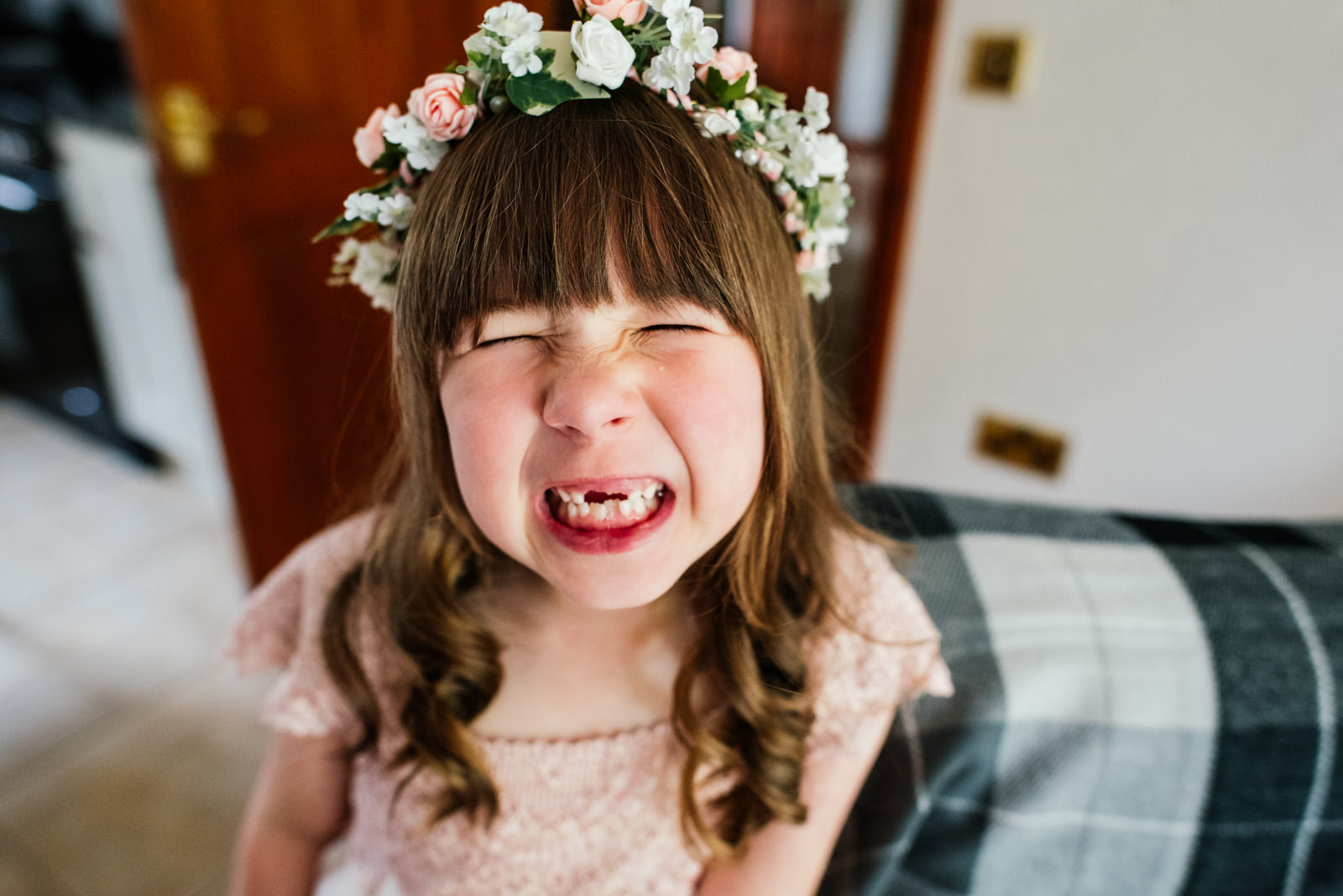 flower girl's cheesy grin
