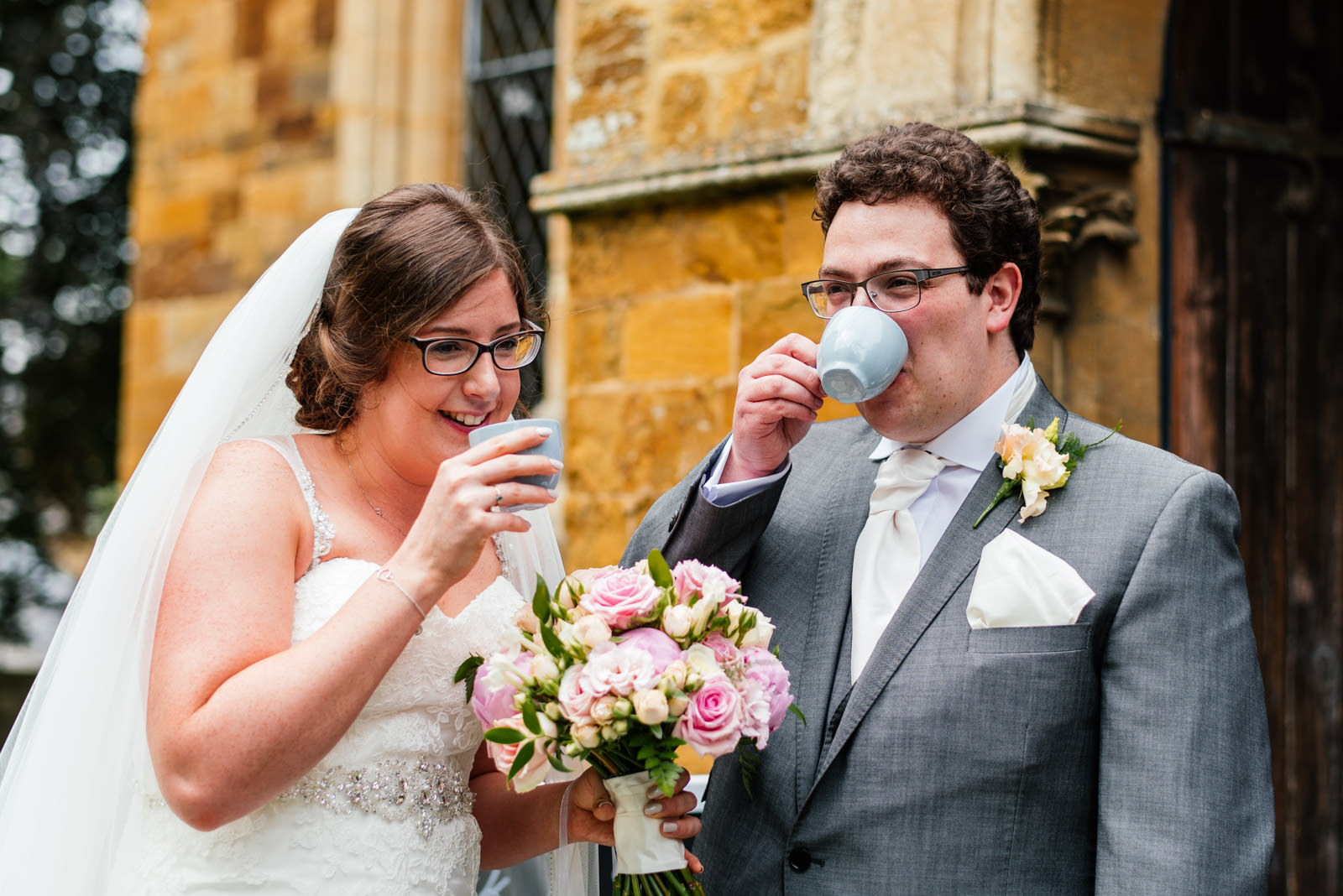 bride and groom enjoy a cup of tea at the church