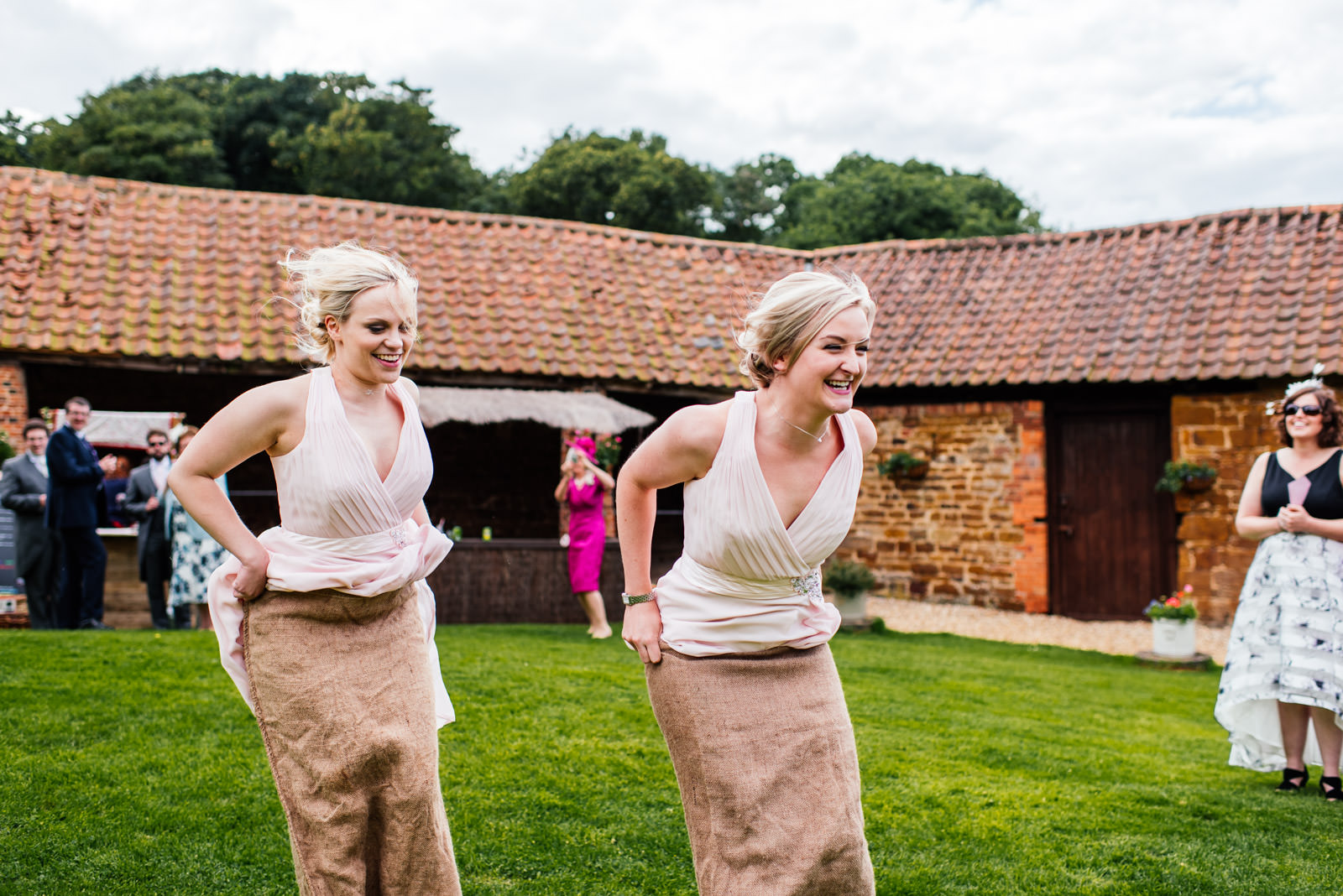 Bridesmaid having a sack race