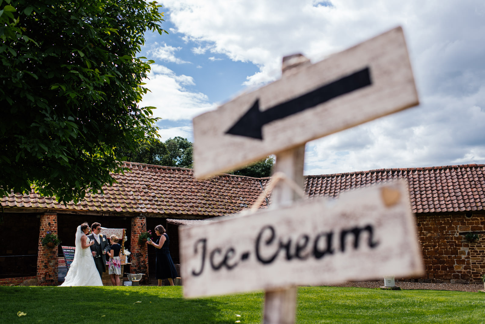 Bride and groom with ice cream sign