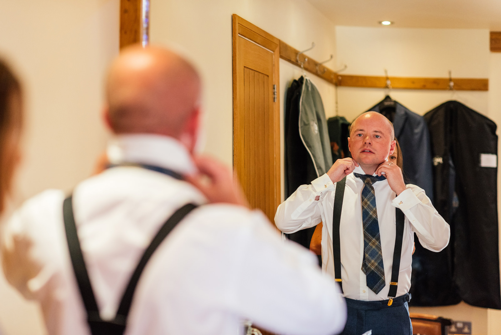 Groom getting ready on wedding day
