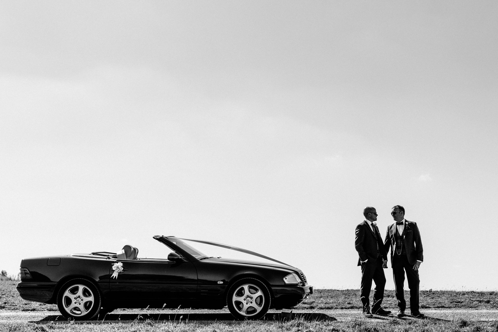grooms and the wedding car