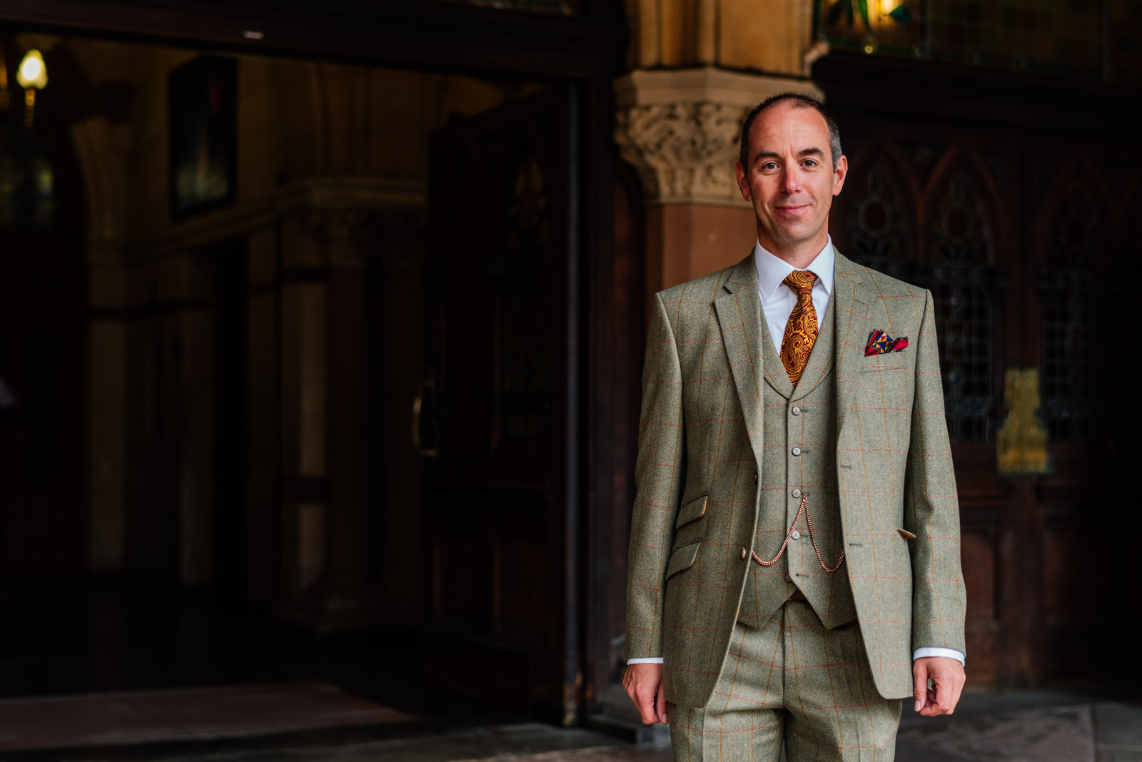 Groom in his tweed suit