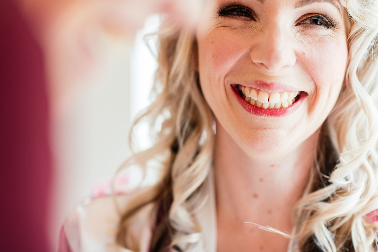 smiling bride during make up