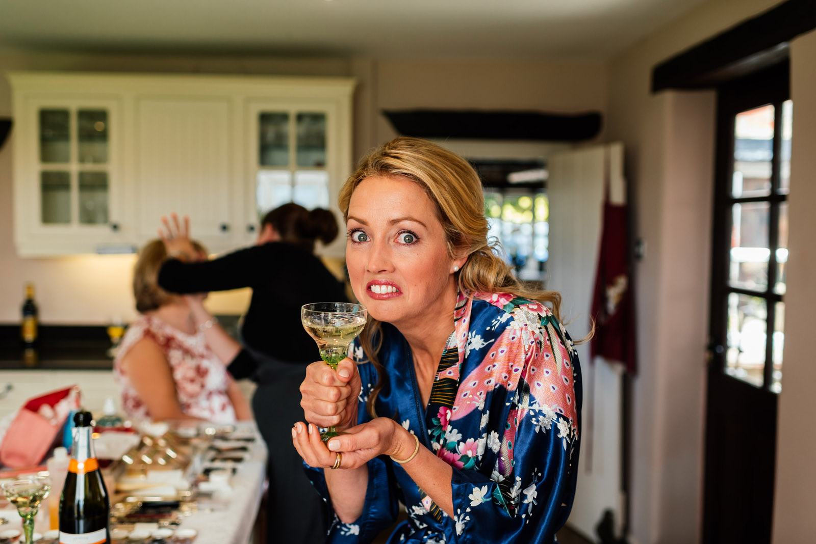 bridesmaid caught having a cheeky drink