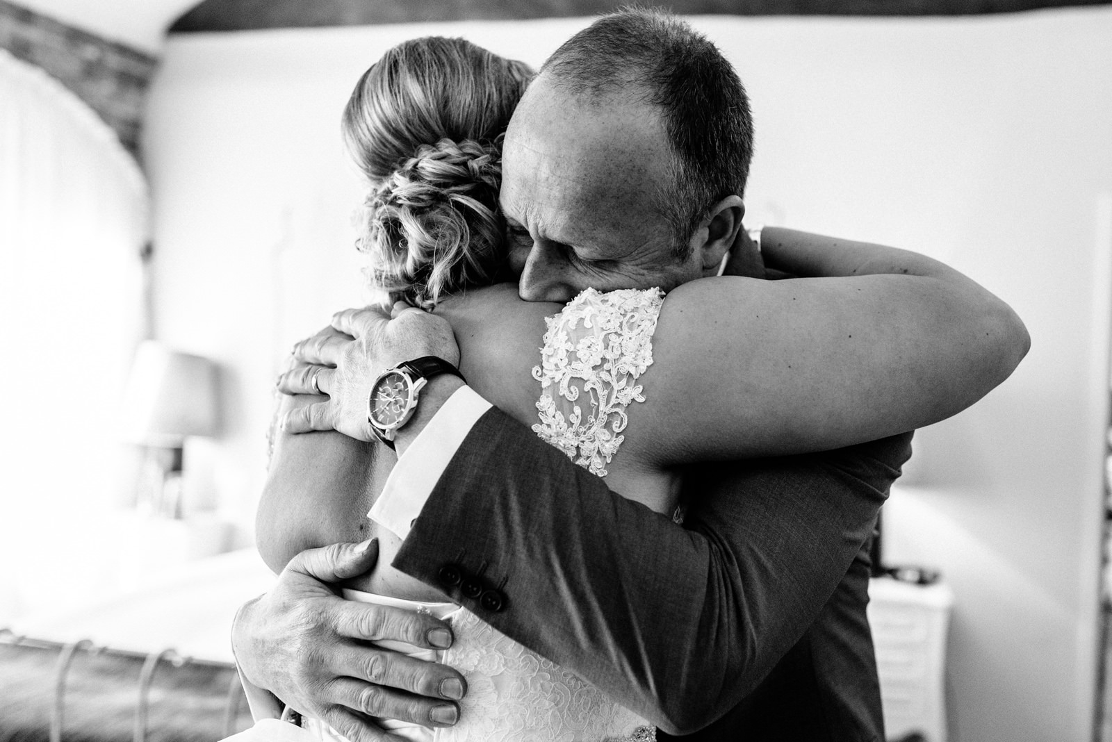 Father hugs his daughter on her wedding day