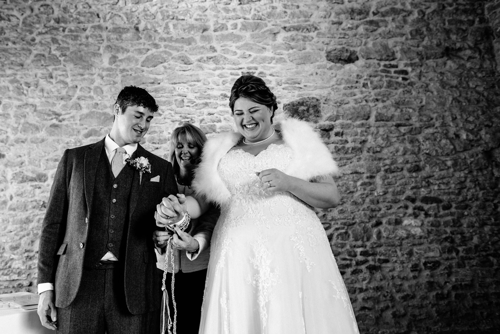 bride and groom tying the knot