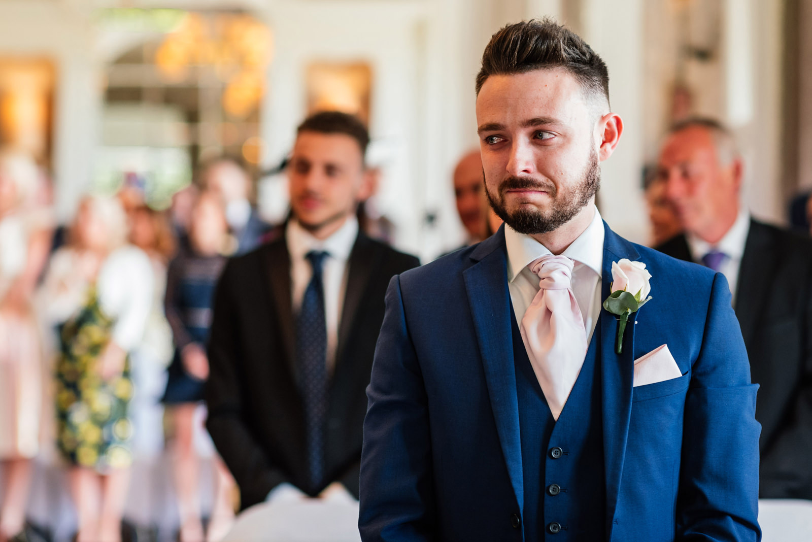 brother of the bride with a tear in his eye