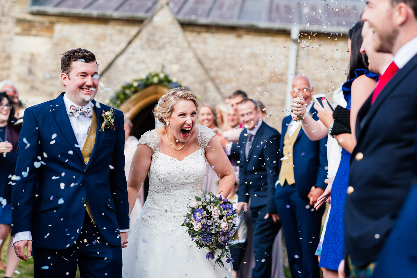 bride being pelted with confetti