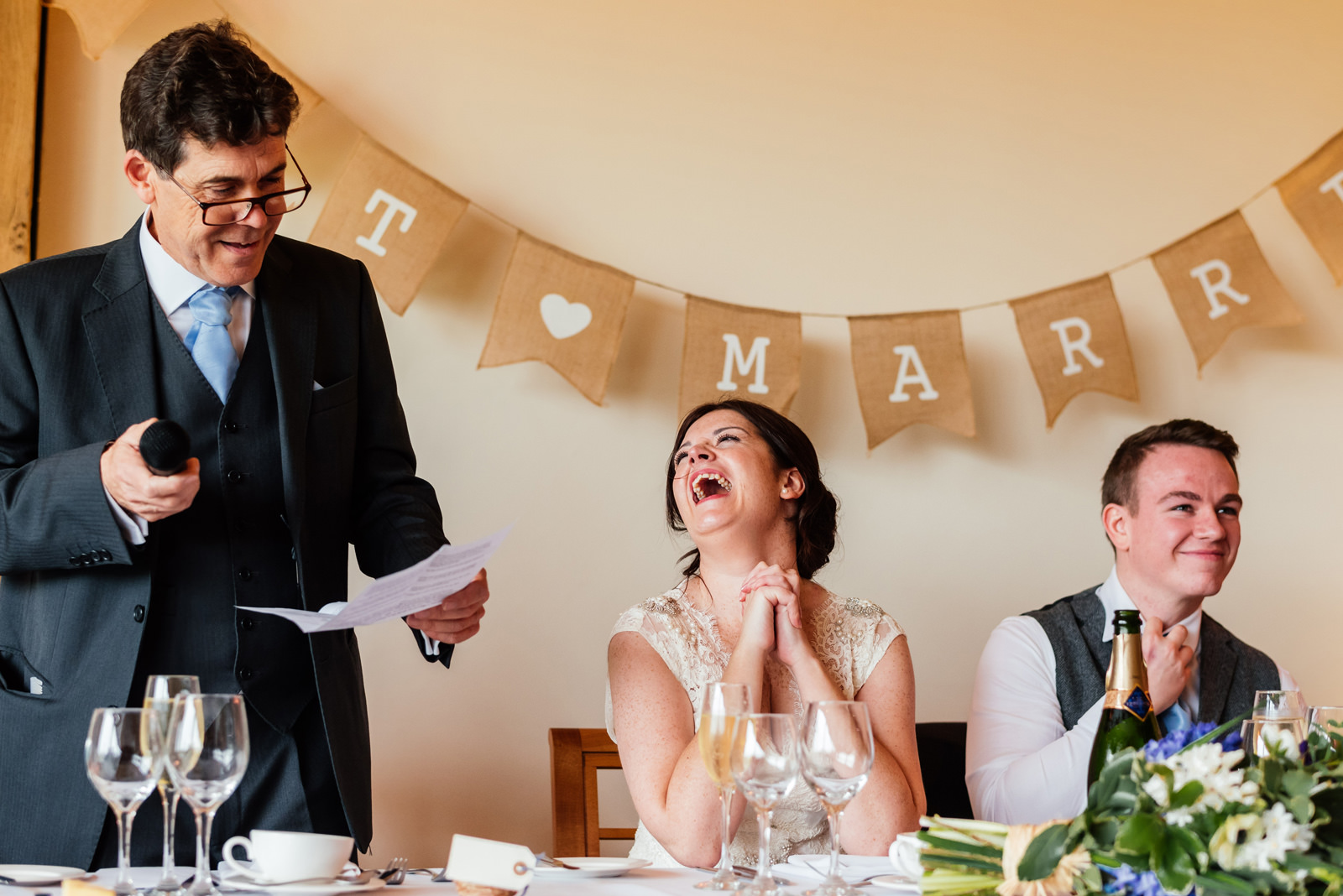 bride laughing at father's speech