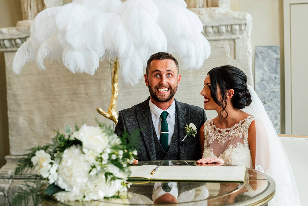 cheesy smile from a happy groom just after getting married