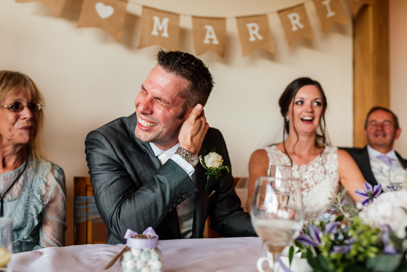 groom embarrassed during the best man speech