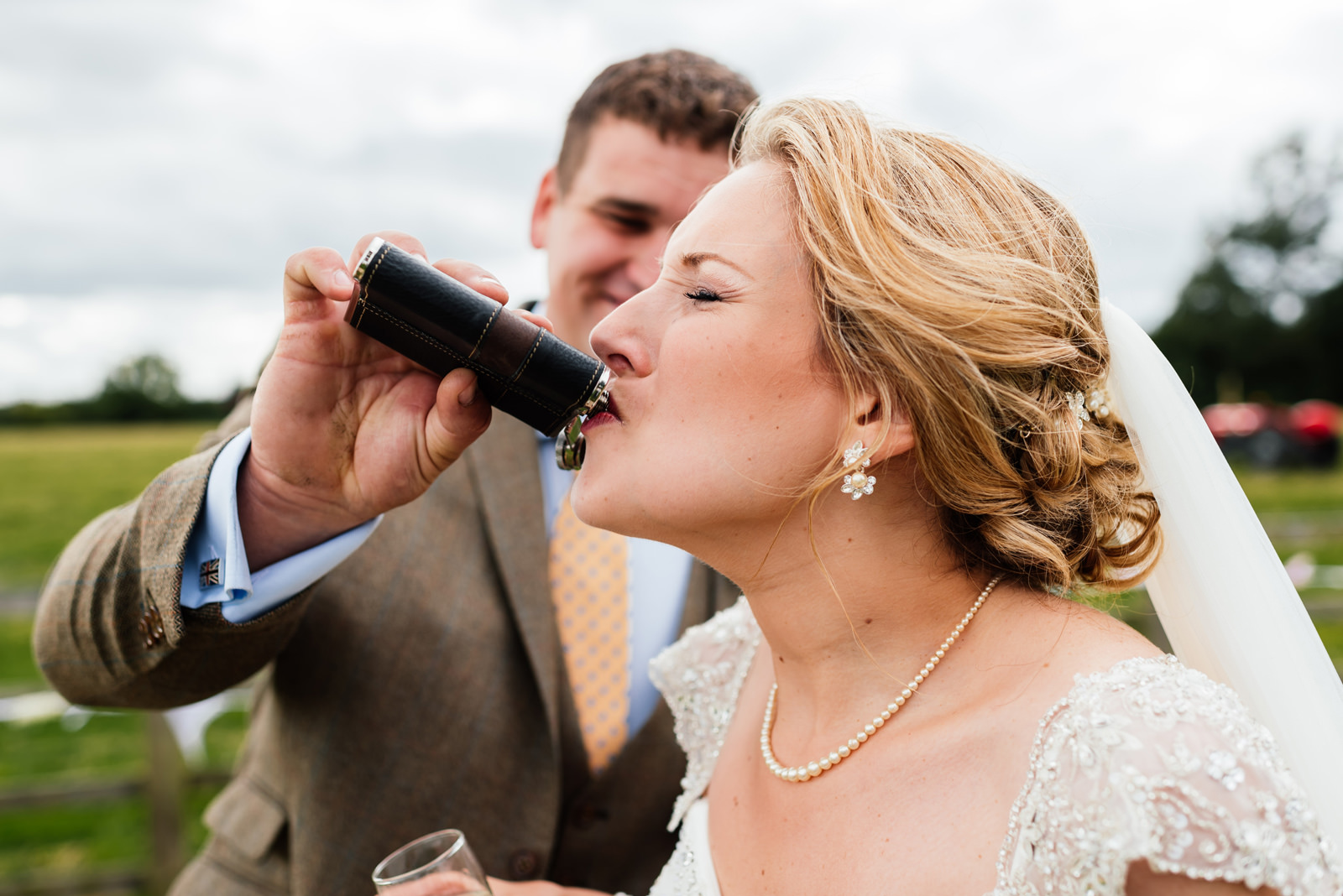 bride having a quick drink