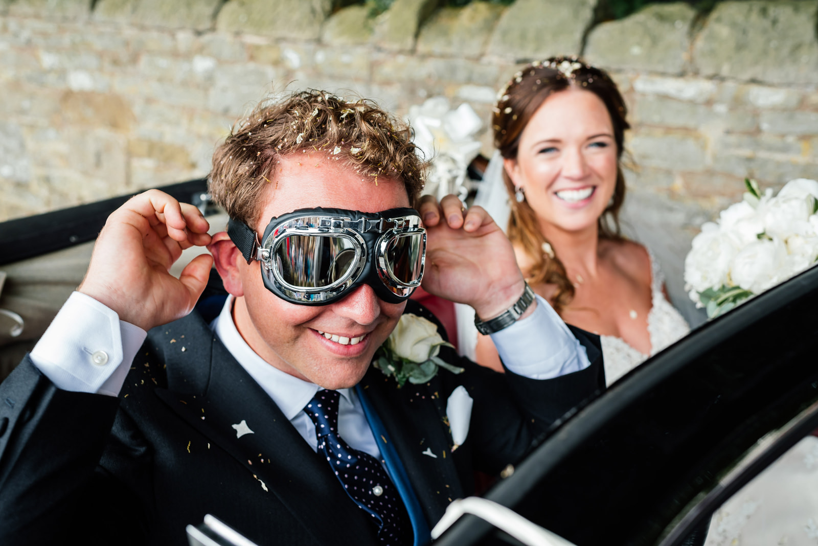 groom in his driving goggles