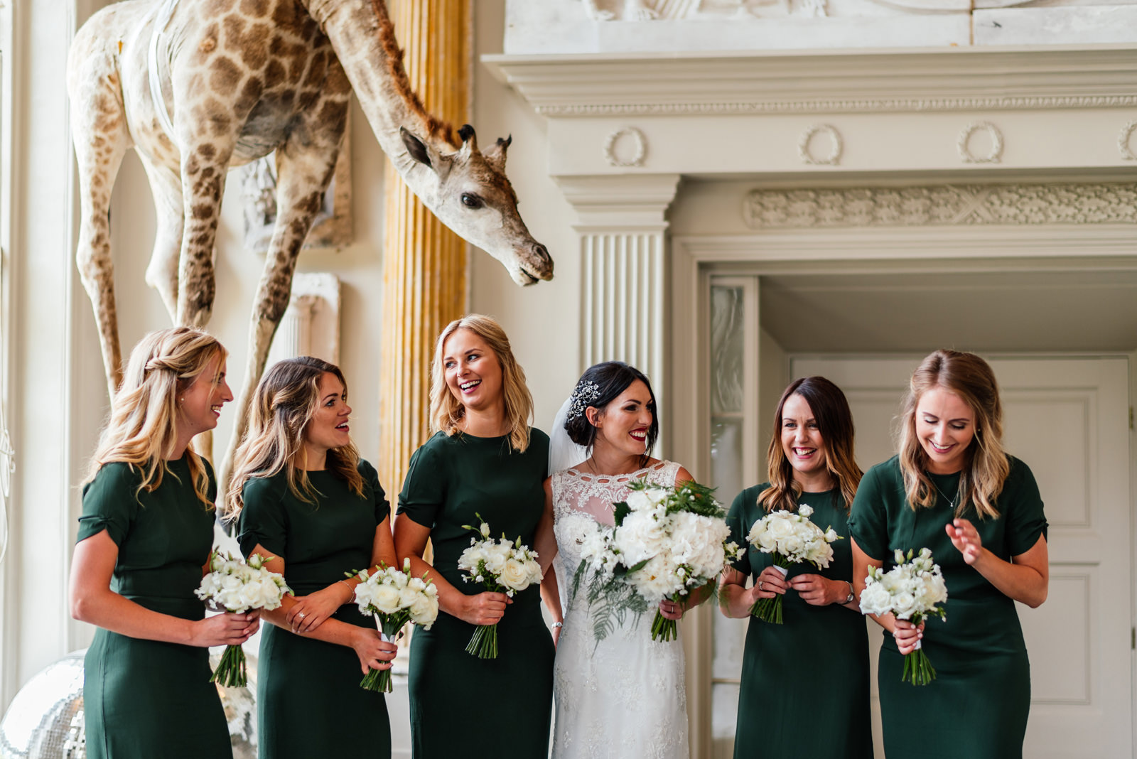 giraffe and bride and bridesmaids