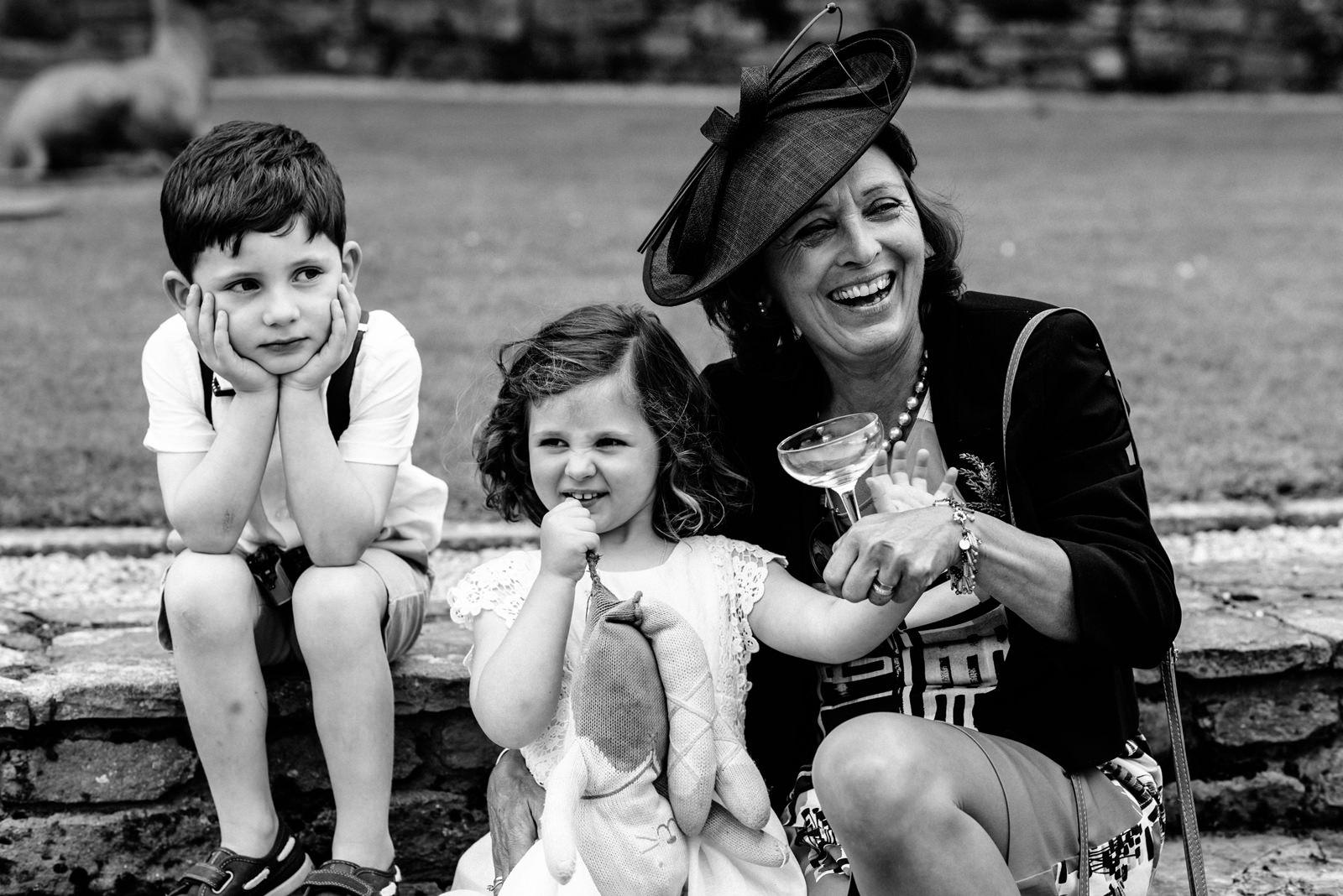 children smiling at wedding