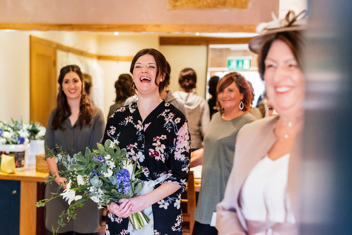 bride laughing with bouquet