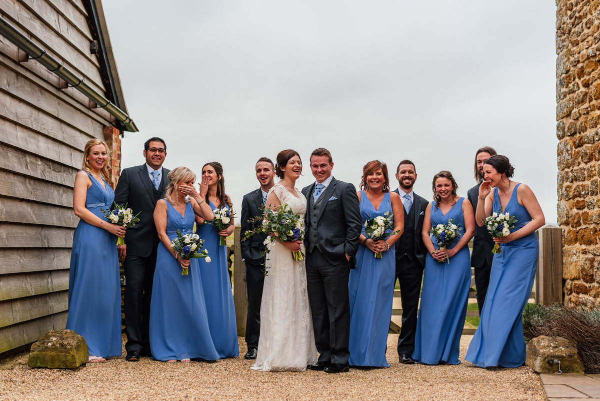 full bridal party laughing