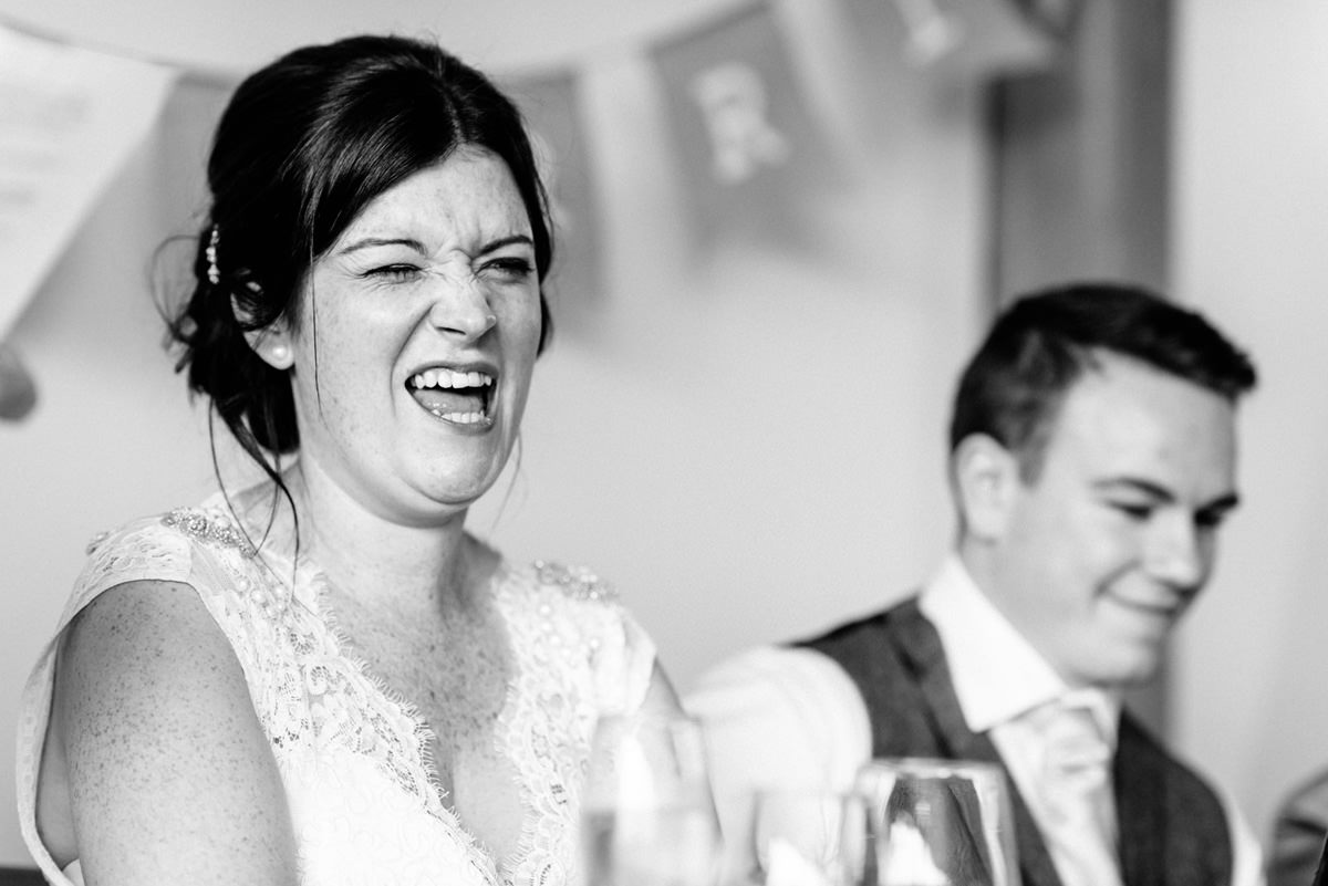 bride pulling funny face during wedding speeches