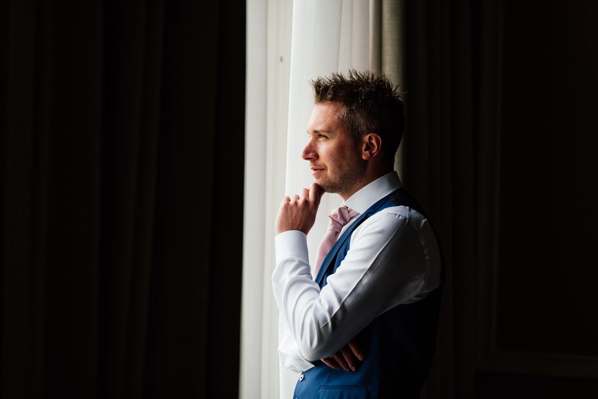 groom waiting on the morning of wedding