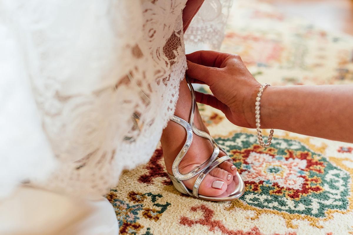 bridal shoes being put on