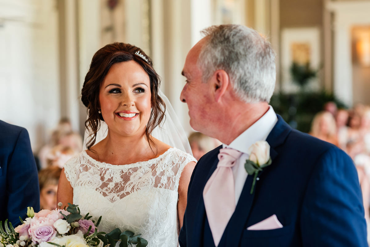 bride smiling at father