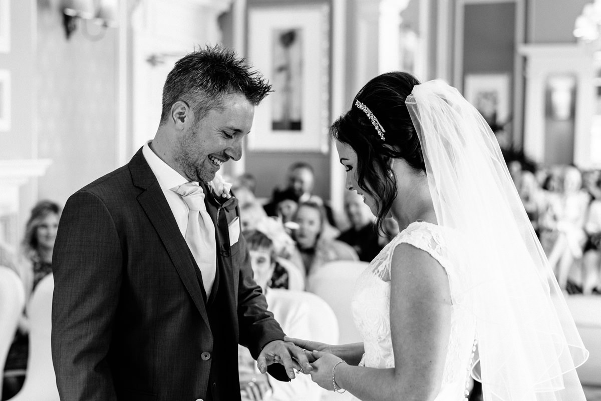 bride and groom exchange rings during marriage ceremony