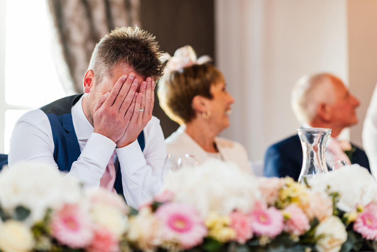 groom embarrassed during best men speeches