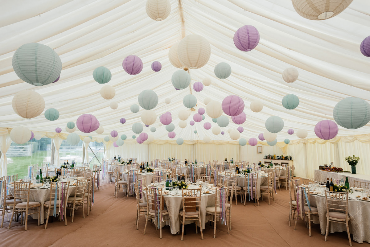 marquee wedding reception with vintage style pompoms