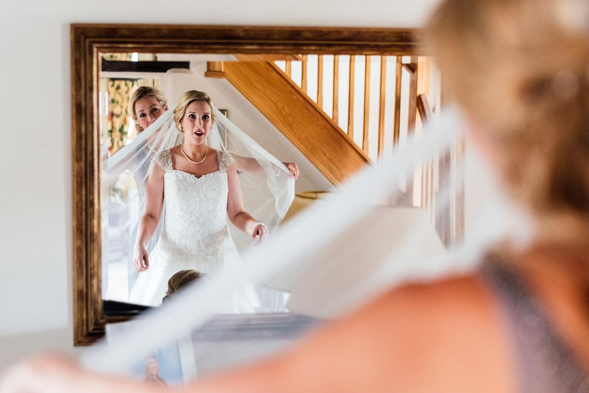 bride has her veil put on