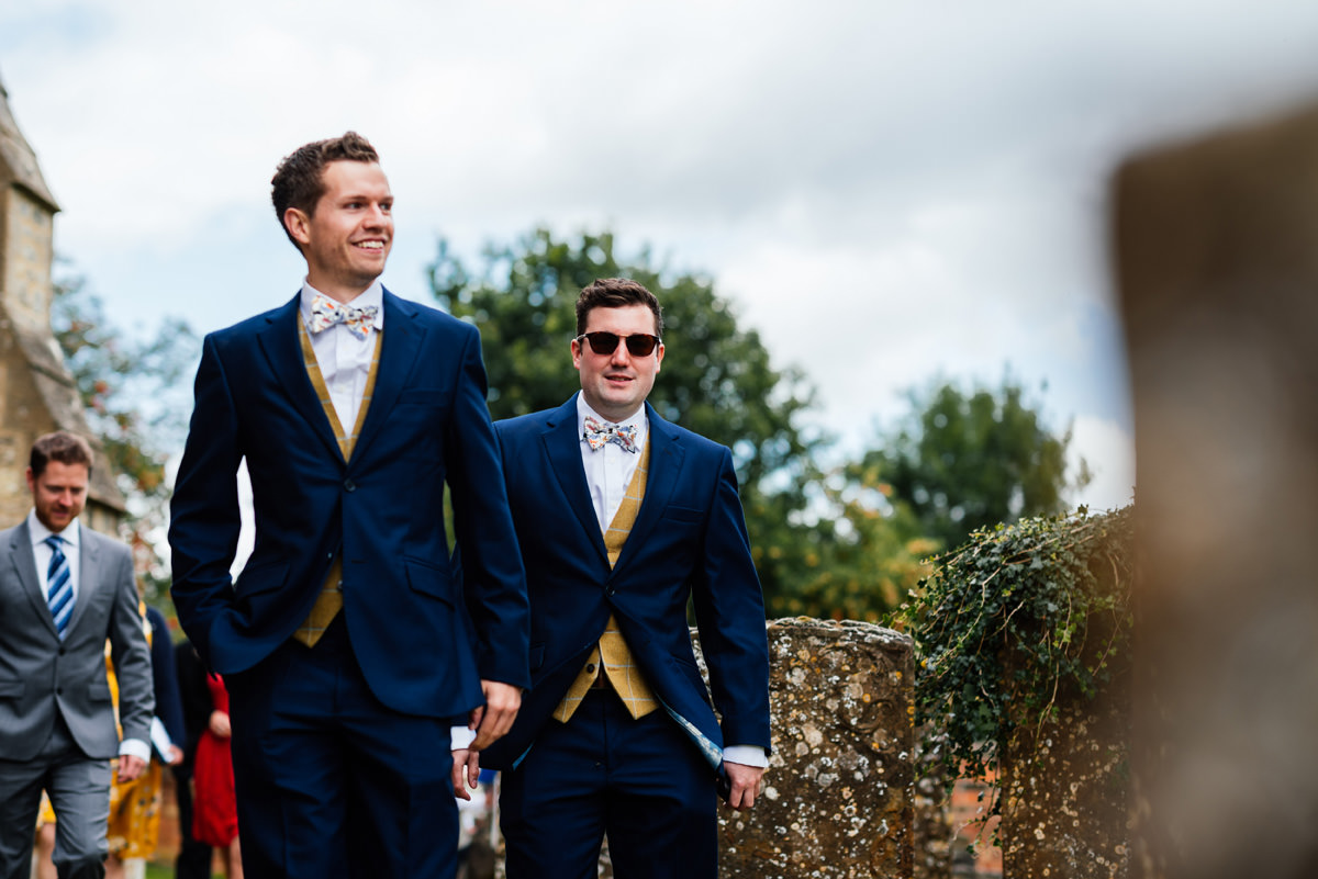 groom arrives at the church with his best man