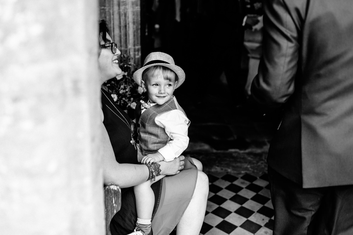 page boy waiting at the church just before wedding ceremony