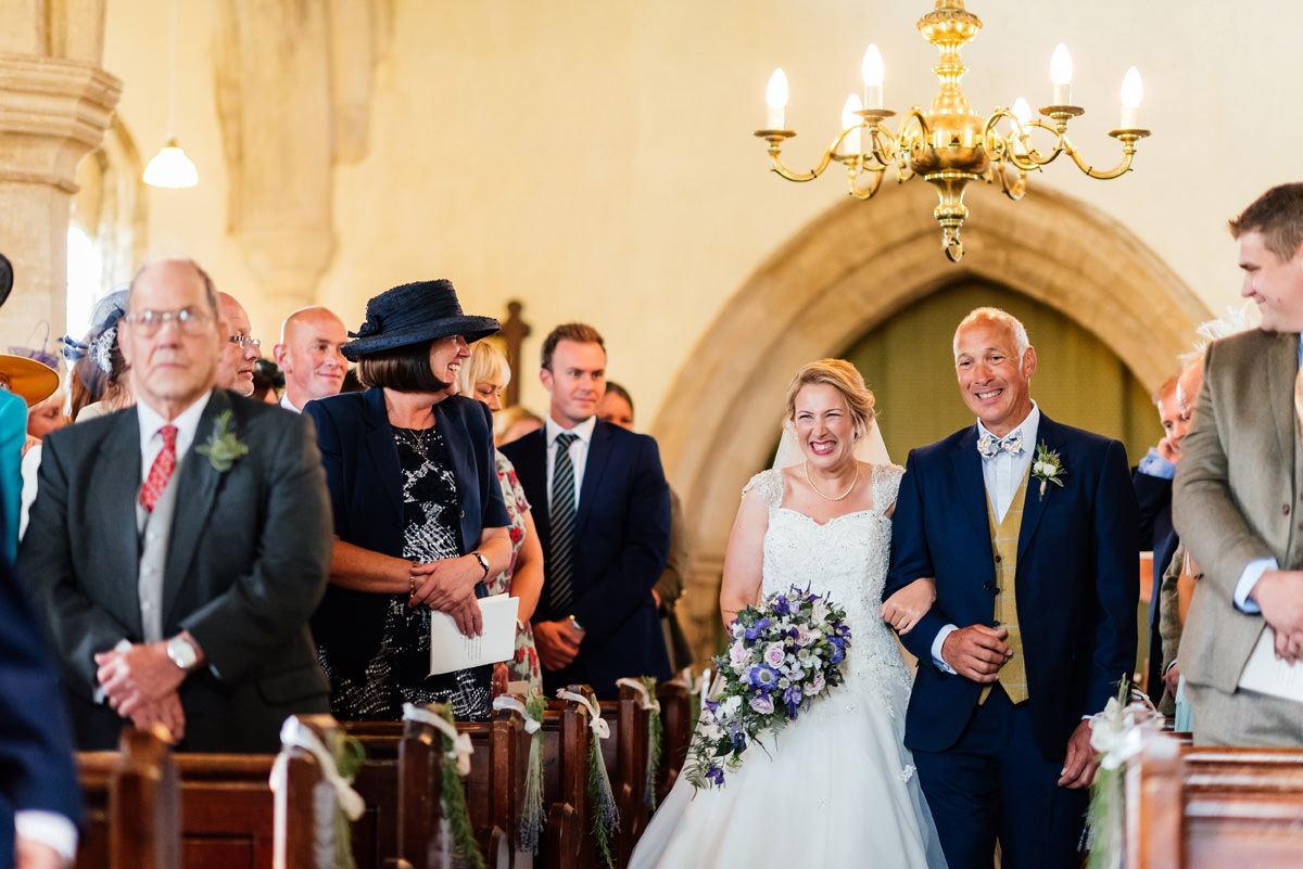 bride arrives at church with father