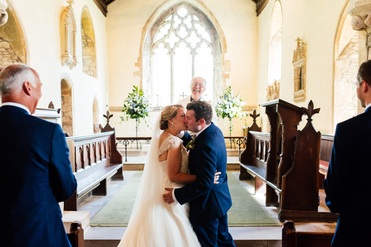 the bride and groom have the first kiss
