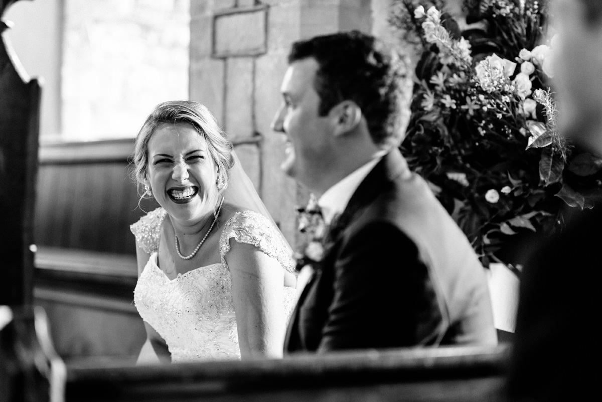 bride smiling during wedding ceremony