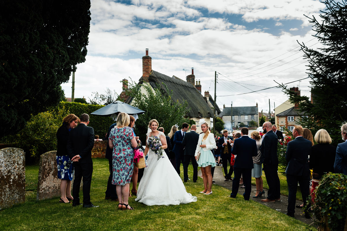 wedding guests gather at the church