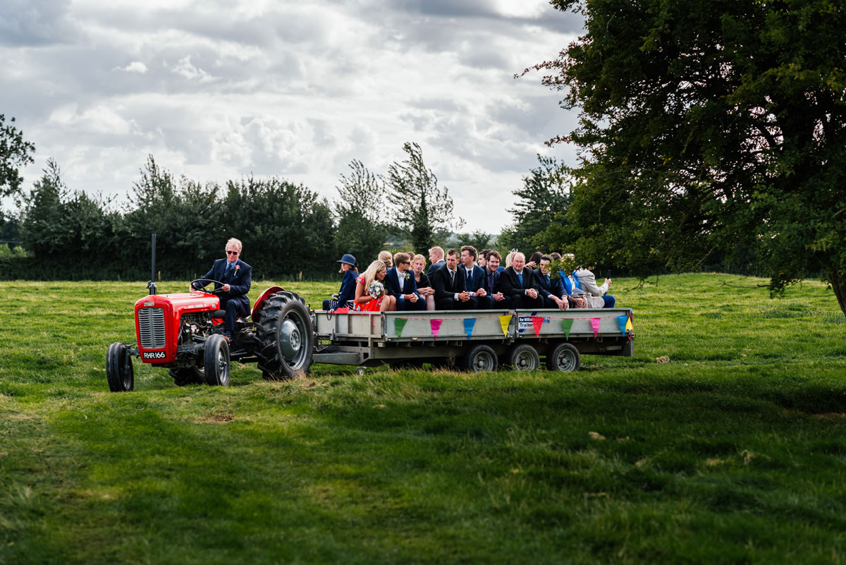 guests being ferried by tractor